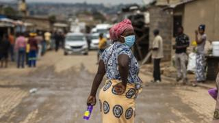 A woman wears a mask in Alexandra, South Africa.