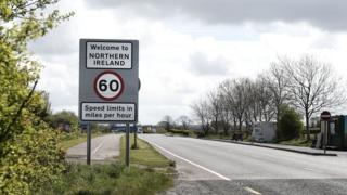 A road sign on the Irish border.