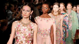 A row of models on the catwalk.