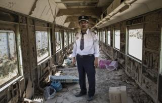 Ali Al-Karkhi inside one of the looted trains