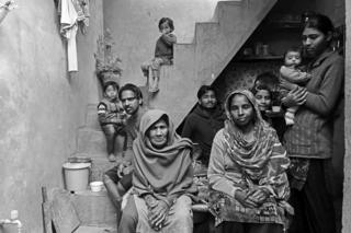 42-year-old Mukeshdevi, a woman manual scavenger, with her husband Sukhraj , mother in-law, five children and two grandchildren in Meerut's Bhagwatpura, India