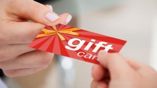 Gift card begin handed over