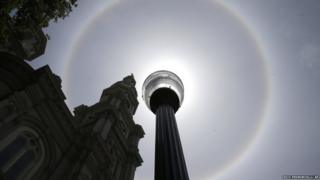 A sun halo is seen over a cathedral