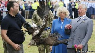 Prince Charles and Duchess of Cornwall with eagle at flower show
