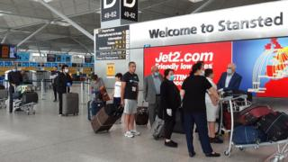 Travellers at Stansted Airport