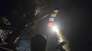 USS Ross fires a tomahawk missile April 7, 2017, at a Syrian air force base