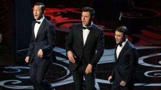 Joseph Gordon-Levitt, Seth MacFarlane and Daniel Radcliffe sing on stage at the Oscars