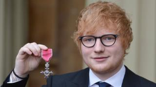 Ed Sheeran with his MBE after Investiture ceremony at Buckingham Palace