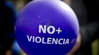 A balloon reading 'No More Violence' can be seen at a demonstration in front of the La Moneda presidential palace in Santiago on June 3, 2015.