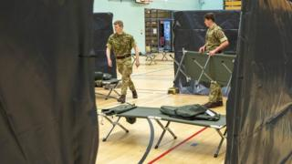 Soldiers build beds