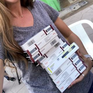 Emily Mackey holding insulin pens she bought in Mexico