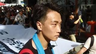 عکس آرشیوی از جیمی شم در جریان یک راهپیمایی اعتراضی