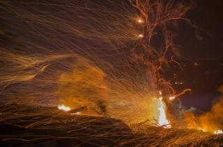 A strong wind blows embers at the Thomas Fire in December 2017 in Montecito, California