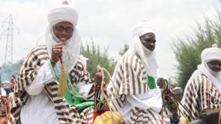 Three Muslim men dey on top horse dey jolly for Eid al-Adha