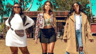 Three women in Wild West clothes for advertising campaign