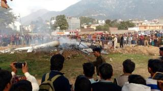 Indian people gather at the site of a crash of the Vaishno Devi bounded helicopter at Katra about 45km from Jammu, the winter capital of Kashmir, India, 23 November 2015