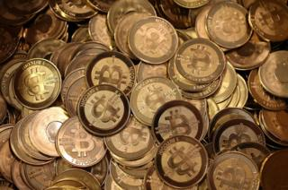 A pile of Bitcoin slugs sit in a box ready to be minted by Software engineer Mike Caldwell in his shop on April 26, 2013 in Sandy, Utah.