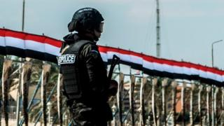 an Egyptian policeman standing guard in the new city of el-Alamien, west of Alexandria