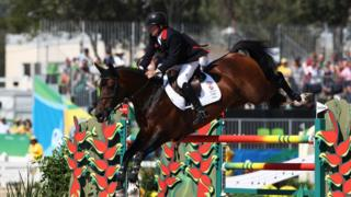 Nick Skelton rides Big Star during the individual jumping third qualifier