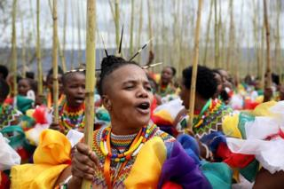 in_pictures Zama Msomi, 36, from KwaMashu leads her group of women during the annual Reed Dance at Enyokeni Royal Palace in Nongoma, South Africa - 7 September 2019