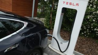 Tesla car at a charging station
