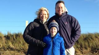 Nancy Harrington, her husband Bren and 11-year-old Jack at the spot the bottle was found