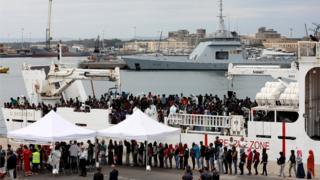 "Migrants disembark Italian coast guard vessel ""Diciotti"" in the port of Catania, Italy"