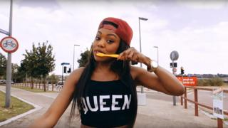 Lady Leshurr brushing her teeth in the Queen's Speech 4