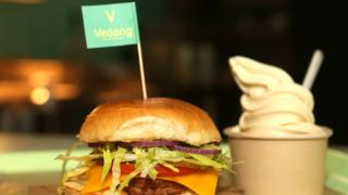 A vegan seitan burger is seen at the Vedang fast food restaurant in the Mall of Berlin on May 18, 2019 in Berlin