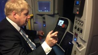 Mayor of London Boris Johnson takes the controls of a Tube simulator