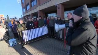 Protestors outside the public inquiry