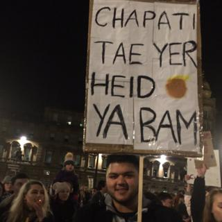 The BBC's Lorna Gordon saw this sign at the Glasgow protest