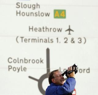 A fan films Concorde at Heathrow Airport