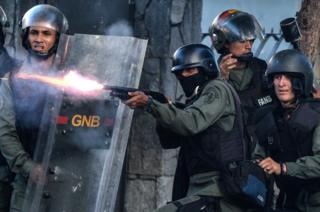 National Guard riot police and opposition demonstrators clash during an anti-government protest in Caracas, on 26 July 2017.