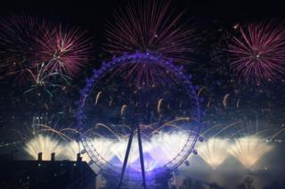 Fireworks light up the sky over the London Eye.