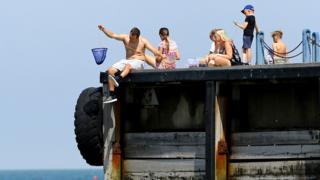 People enjoy the warm weather on the beach in Whitstable