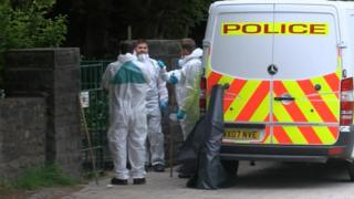 Forensic officers on site in the Quaker memorial garden