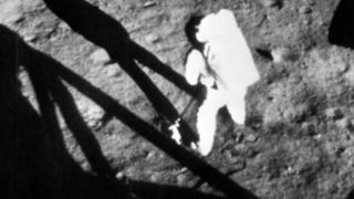Neil Armstrong becomes the first person to set foot on the moon