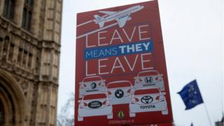 A 'Leave Means Leave' sign the Houses of Parliament with reference to the car manufacturer Honda, who announced today that they are to close their Swindon plant in 2022, on February 18, 2019 in London, England.