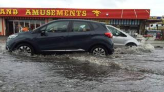 Cars driving through flood water in Canvey