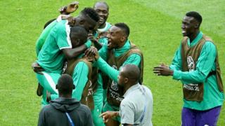 Senegal team celebrate dia win over Poland