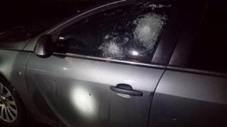 Bullet holes in car