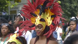 Woman in elaborate headdress in parade