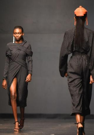 Designs by Fruche are modeled on the catwalk during Lagos Fashion Week.