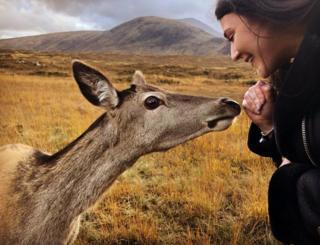 Deer and girl in Glencoe