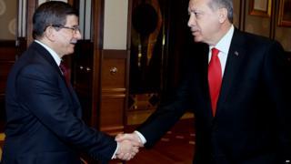 Ahmet Davutoglu (left) and Recep Tayyip Erdogan shakes hands before a meeting in Ankara - 25 August 2015