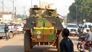 UN peacekeepers patrol in their armoured personnel carriers (APC) along a street during the presidential election in the mainly Muslim PK-5 neighbourhood in Bangui CAR