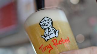 Pint of Tiny Rebel beer being poured