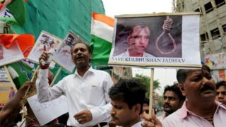 National Congress activists hold photographs of Indian national, Kulbhushan Jadhav, and placards against Prime Minister Narendra Modi in Calcutta, Eastern India 24 April 2017,