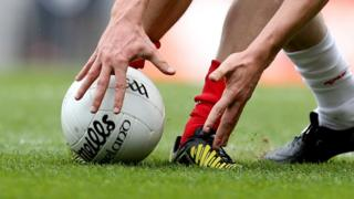 Man lifting GAA ball
